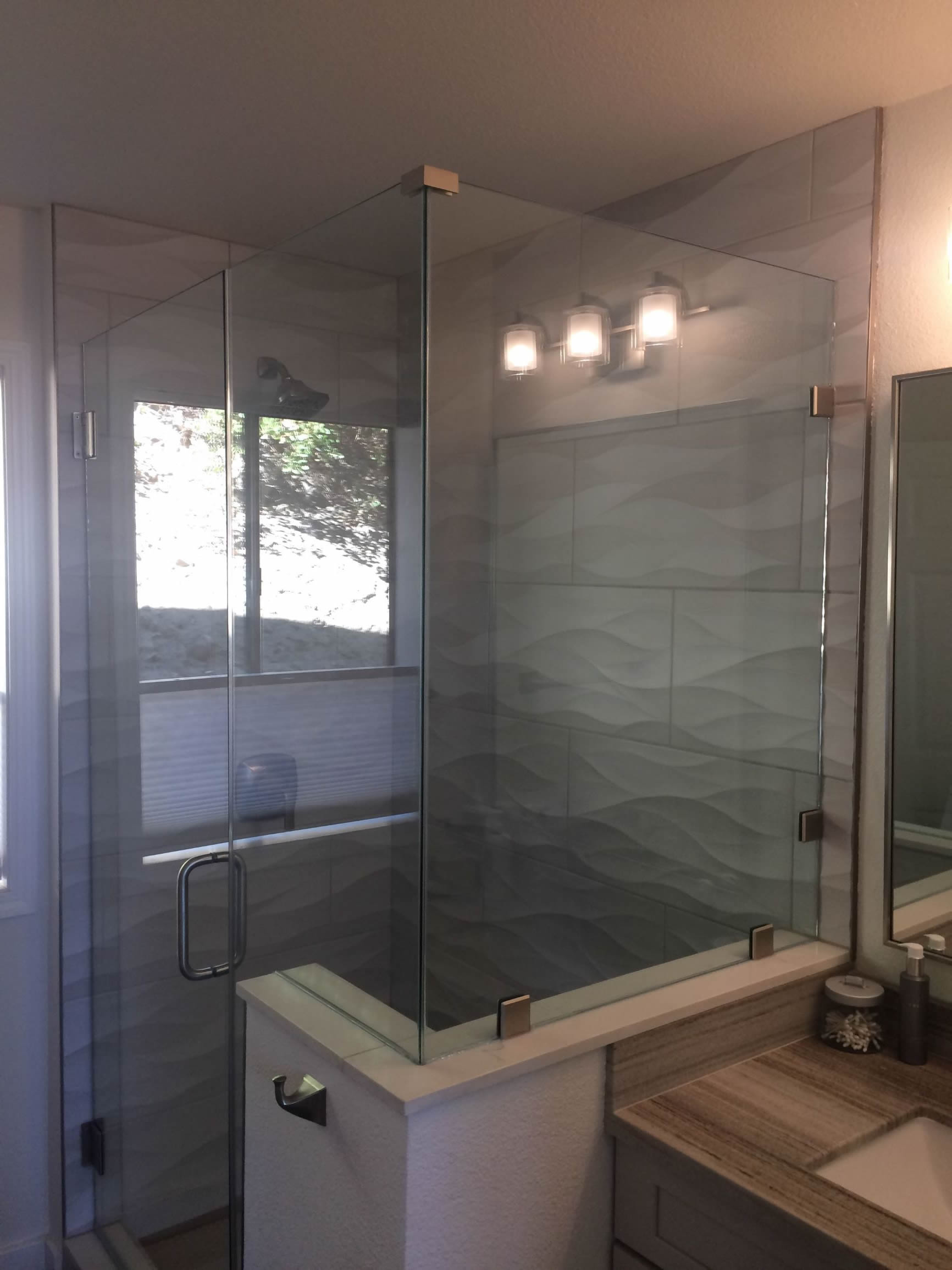 Frameless shower enclosure with brushed nickel hardware january 2019